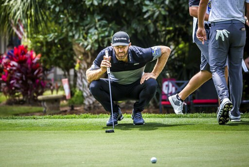 (Scott Schroeder/The Island Packet via AP). Dustin Johnson eyes his birdie putt on the 8th green during the second round of the RBC Heritage golf tournament in Hilton Head Island, S.C., Friday, April 19, 2019.