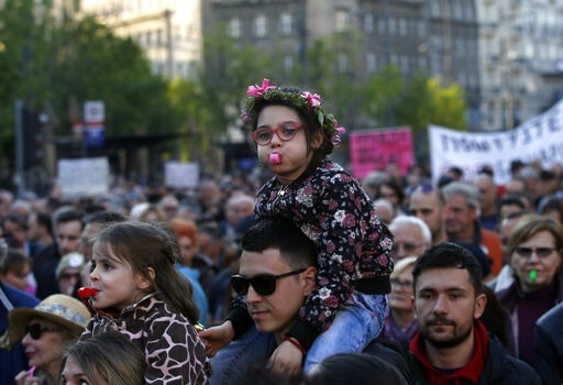 (AP Photo/Darko Vojinovic). A girl blows a whistle during a protest march against President Aleksandar Vucic in Belgrade, Serbia, Saturday, April 20, 2019. Thousands of people have rallied in Serbia's capital for 20th week in a row against populist Pre...
