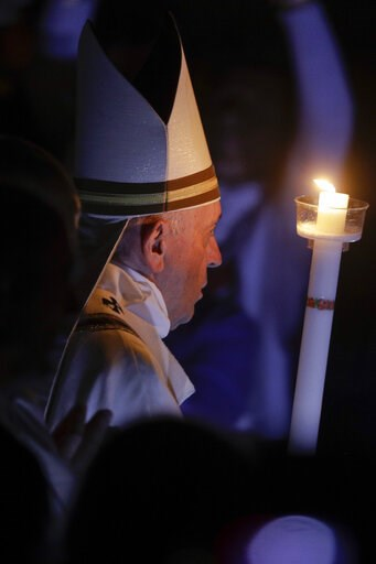 (AP Photo/Gregorio Borgia). Pope Francis holds a candle as he presides over a solemn Easter vigil ceremony in St. Peter's Basilica at the Vatican, Saturday, April 21, 2019.