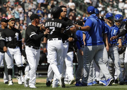 (AP Photo/Nam Y. Huh). Chicago White Sox's Tim Anderson (7) is restrained by Jose Abreu after he was hit by a pitch from the Kansas City Royals, as benches cleared during the sixth inning of a baseball game in Chicago, Wednesday, April 17, 2019. The Ro...