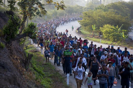 (AP Photo/Moises Castillo). Central American migrants, part of a caravan hoping to reach the U.S. border, move on the road in Escuintla, Chiapas State, Mexico, Saturday, April 20, 2019. Thousands of migrants in several different caravans have been gath...
