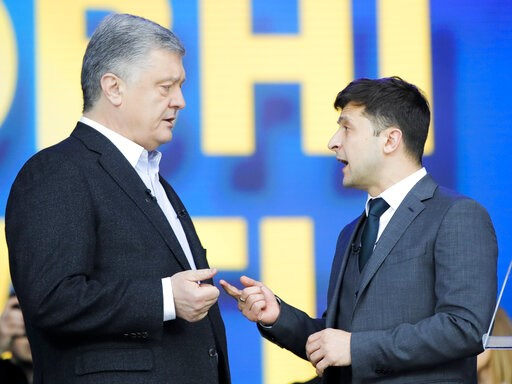 (AP Photo/Vadim Ghirda). Ukrainian President Petro Poroshenko, left, and Ukrainian presidential candidate and popular comedian Volodymyr Zelenskiy, right, argue their debates at the Olympic stadium in Kiev, Ukraine, Friday, April 19, 2019. Friday is th...