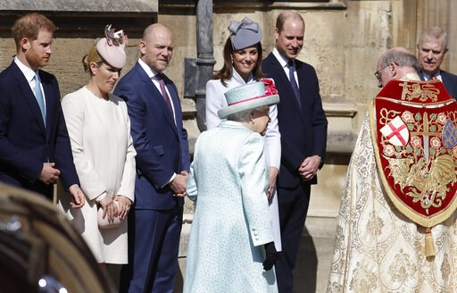 (AP Photo/Kirsty Wigglesworth, pool). Members of Britain's Royal family watch as Britain's Queen Elizabeth II arrives to attend the Easter Mattins Service at St. George's Chapel, at Windsor Castle in England Sunday, April 21, 2019.