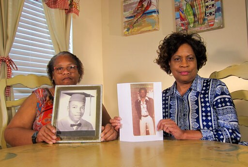 (AP Photo/Juan Lozano). In this Wednesday, April 10, 2019, photo Mylinda Byrd Washington, 66, right, and Louvon Byrd Harris, 61, hold up photographs of their brother James Byrd Jr. in Houston. James Byrd Jr. was the victim of what is considered to be o...