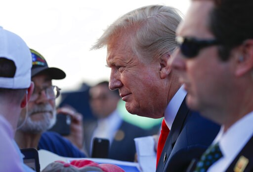 (AP Photo/Pablo Martinez Monsivais). President Donald Trump leans in to listen to his supporters on the tarmac upon his arrival at Palm Beach International Airport, Thursday, April 18, 2019, in West Palm Beach, Fla. Trump traveled to Florida to spend t...