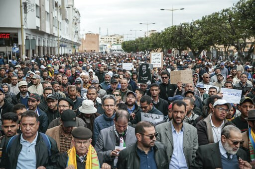 (AP Photo/Mosa'ab Elshamy). Thousands of Moroccans take part in a demonstration in Rabat, Morocco, Sunday, April 21, 2019. Protesters are condemning prison terms for the leader of the Hirak Rif protest movement against poverty and dozens of other activ...
