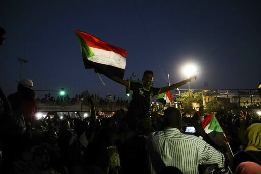 (AP Photo). Sudanese protesters chant slogans during a rally outside the army headquarters in Sudan's capital Khartoum on Saturday, April 20, 2019. Sudan's military ousted President Omar al-Bashir following four months of street protests against his ru...
