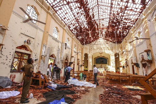 (AP Photo/Chamila Karunarathne). Dead bodies of victims lie inside St. Sebastian's Church damaged in blast in Negombo, north of Colombo, Sri Lanka, Sunday, April 21, 2019.  More than two hundred people were killed and hundreds more injured in eight bla...