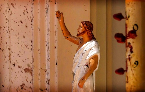 (AP Photo). Blood stains are seen on the wall and on a Jesus Christ statue at the St. Sebastian's Church after blast in Negombo, north of Colombo, Sri Lanka, Sunday, April 21, 2019. More than two hundred people were killed and hundreds more injured in ...