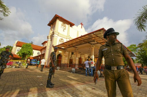 (AP Photo/Chamila Karunarathne). Sri Lankan army soldiers secure the area around St. Sebastian's Church damaged in blast in Negombo, north of Colombo, Sri Lanka, Sunday, April 21, 2019.  More than hundred were killed and hundreds more hospitalized with...