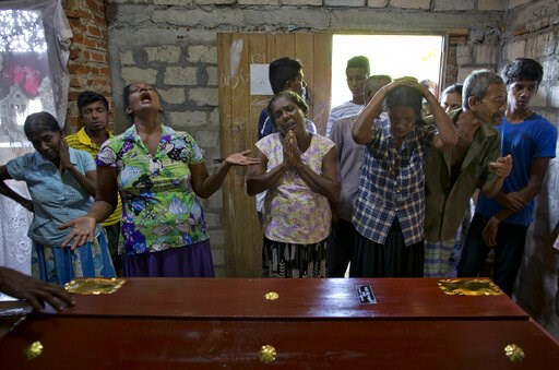 (AP Photo/Gemunu Amarasinghe). Relatives weep near the coffin with the remains of 12-year Sneha Savindi, who was a victim of Easter Sunday bombing at St. Sebastian Church, Monday, April 22, 2019 in Negombo, Sri Lanka. Easter Sunday bombings of churches...
