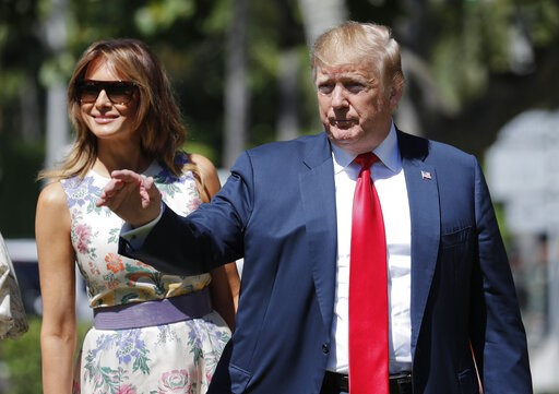 (AP Photo/Pablo Martinez Monsivais). President Donald Trump, right, gestures as he and first lady Melania Trump, left, arrive for Easter services at Episcopal Church of Bethesda-by-the-Sea, Sunday, April 21, 2019, in Palm Beach, Fla.