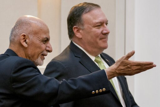 (AP Photo/Andrew Harnik, Pool, File). FILE - In this July 9, 2018 file photo, Afghan President Ashraf Ghani, left, and Secretary of State Mike Pompeo, arrive for a news conference in Kabul, Afghanistan. U.S. Secretary of State Mike Pompeo called the Af...