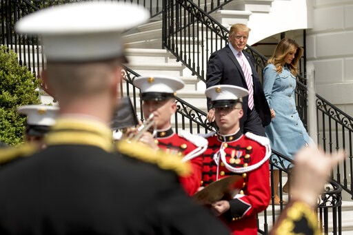 (AP Photo/Andrew Harnik). President Donald Trump and first lady Melania Trump arrive for the annual White House Easter Egg Roll on the South Lawn of the White House, Monday, April 22, 2019, in Washington.