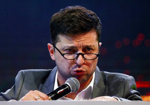 (AP Photo/Efrem Lukatsky, file). FILE - In this Friday, March 29, 2019 file photo, Volodymyr Zelenskiy, Ukrainian actor and candidate in the upcoming presidential election, hosts a comedy show at a concert hall in Brovary, Ukraine. For his presidential...