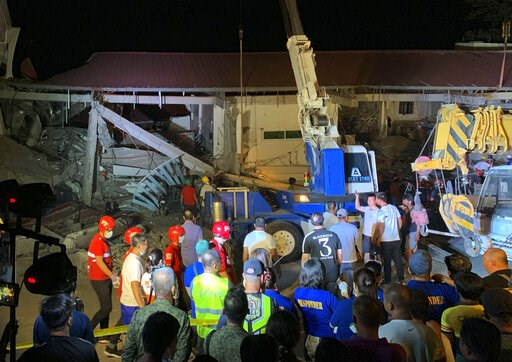 (AP Photo/Bullit Marquez). Workers continue rescue efforts on people still trapped inside a collapsed building at Porac town, Pampanga province, northern Philippines Monday, April 22, 2019. A strong 6.1 magnitude earthquake in the north Philippines on ...