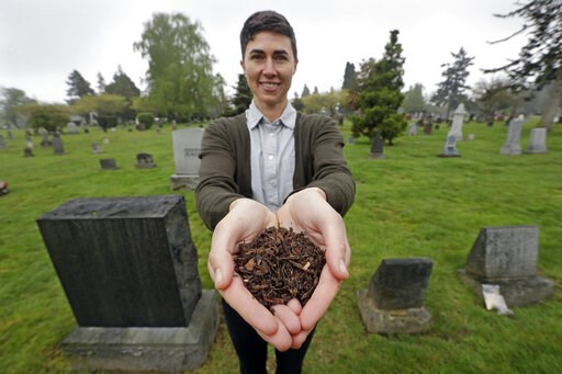 (AP Photo/Elaine Thompson). In this Friday, April 19, 2019, photo Katrina Spade, the founder and CEO of Recompose, displays a sample of the compost material left from the decomposition of a cow, using a combination of wood chips, alfalfa and straw, as ...