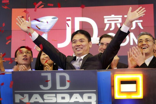 (AP Photo/Mark Lennihan, File). FILE - In this file photo taken May 22, 2014, Liu Qiangdong, also known as Richard Liu, CEO of JD.com, raises his arms to celebrate the IPO for his company at the Nasdaq MarketSite, in New York. A woman who said she was ...