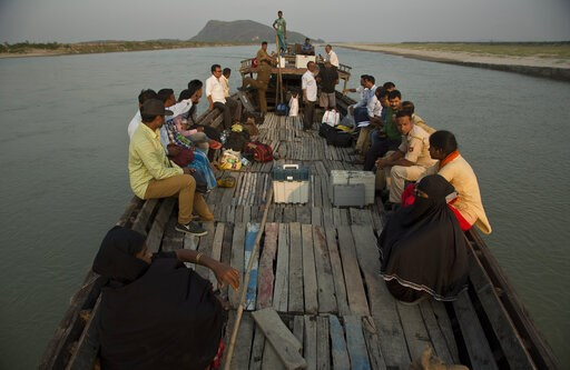 (AP Photo/Anupam Nath). Indian election officials with polling materials travel on a country boat to reach a polling center in a remote river island in the River Brahmaputra in Kamrup district, west of Gauhati, Assam, India, Monday, April 22, 2019. Tue...