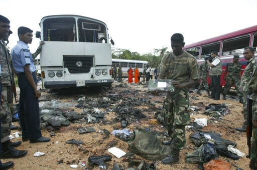 (AP Photo/Eranga Jayawardena, File). FILE - In this Oct. 16, 2006, file photo, a Sri Lankan soldier inspects the debris at the site of a suicide explosion by Tamil Tigers near Dambulla, about 150 kilometers (90 miles) northeast of Colombo, Sri Lanka. T...