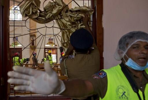 (AP Photo/Gemunu Amarasinghe). Investigators at the scene of a suicide bombing at St. Sebastian Church in Negombo, Sri Lanka, Monday, April 22, 2019. Easter Sunday bombings of churches, luxury hotels and other sites was Sri Lanka's deadliest violence s...