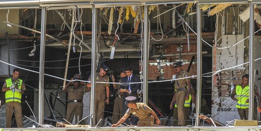 (AP Photo/Chamila Karunarathne, file). In this Sunday April 21, 2019, photo, a Sri Lankan Police officer inspects a blast spot at the Shangri-la hotel in Colombo, Sri Lanka. Sri Lankan authorities blame seven suicide bombers of a domestic militant grou...