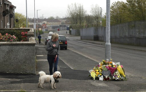 (Brian Lawless/PA via AP). A woman reacts as she stops to pay her respects at the scene Saturday April 20, 2019, in Londonderry, Northern Ireland, where 29-year old journalist Lyra McKee was fatally shot. Police in Northern Ireland on Saturday arrested...