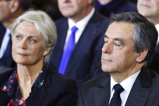 (AP Photo/Christophe Ena, File). FILE - In this Jan. 29, 2017 file photo, conservative presidential candidate Francois Fillon and his wife Penelope attend a campaign meeting in Paris. A French judicial official says investigating judges have requested ...