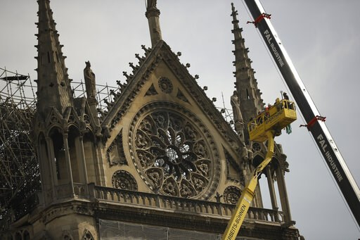 (AP Photo/Francisco Seco). Technicians work in a crane next to the Notre Dame cathedral in Paris, Monday, April 22, 2019. n the wake of the fire last week that gutted Notre Dame, questions are being raised about the state of thousands of other cathedra...