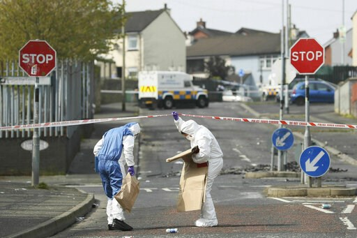 (Brian Lawless/PA via AP). Police forensic officers at the scene in Londonderry, Northern Ireland, Friday April 19, 2019, following the death of 29-year-old journalist Lyra McKee who was shot and killed during overnight rioting.  Police in Northern Ire...