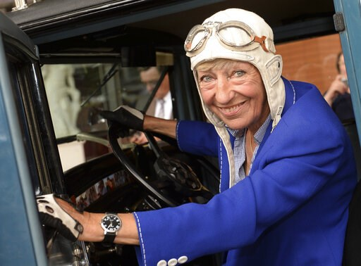 (Britta Pedersen/dpa via AP). FILE-In this July 24, 2014 file photo Heidi Hetzer poses at a Hudson Great Eight Oldtimer (1930) in Berlin, Germany. Businesswoman Heidi Hetzer, whose late-in-life decision to drive around the world in an American vintage ...