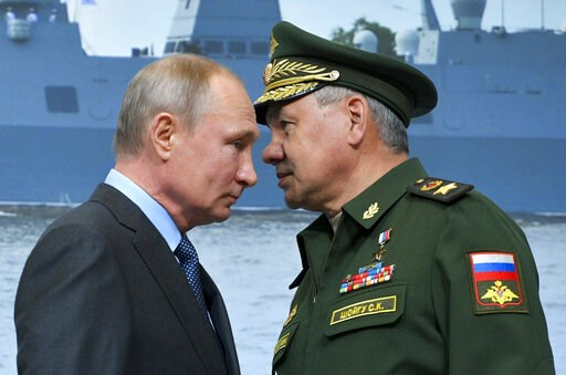 (Alexei Druzhinin, Sputnik, Kremlin Pool Photo via AP). Russian President Vladimir Putin, left, and Russian Defense Minister Sergei Shoigu during a visit a shipyard in St. Petersburg, Russia, Tuesday, April 23, 2019. Putin said the government will purs...