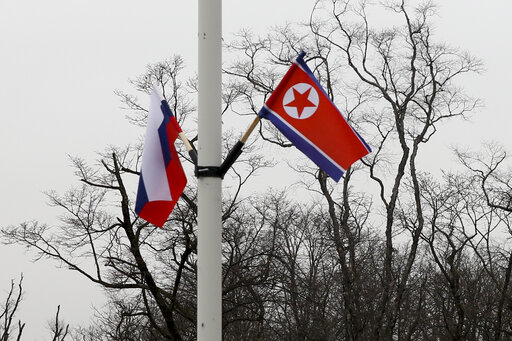 (AP Photo/Mari Borodina). Flags of Russia and North Korea, right, are seen along the road on Russky Island, in Vladivostok, Russia, Tuesday, April 23, 2019. Russian President Vladimir Putin will meet with North Korean leader Kim Jong Un for a much-anti...