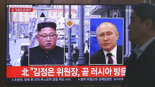 (AP Photo/Ahn Young-joon). A man passes by a TV screen showing images of North Korean leader Kim Jong Un, left, and Russian President Vladimir Putin, right, during a news program at the Seoul Railway Station in Seoul, South Korea, Tuesday, April 23, 20...