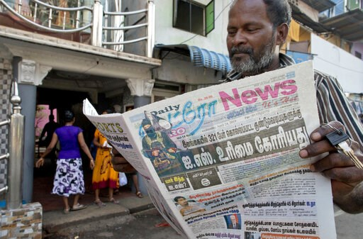 (AP Photo/Gemunu Amarasinghe). A man reads a newspaper with a lead story on Islamic State taking responsibility of Easter Sunday terror attacks in Colombo, Sri Lanka, Wednesday, April 24, 2019.