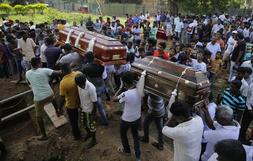 "(AP Photo/Eranga Jayawardena, File). FILE - In this Tuesday, April 23, 2019, file photo, Sri Lankans carry the coffins carrying victims of the Easter Sunday bombings in Colombo, Sri Lanka. The U.S. ambassador says America had ""no prior knowledge"" of a ..."
