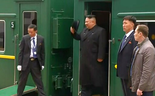 (RU-RTR Russian Television via AP). In this image taken from the RU-RTR Russian television, North Korean leader Kim Jong Un smiles as he leaves a train in Vladivostok railway station in Vladivostok, Russia, Wednesday, April 24, 2019. North Korean leade...
