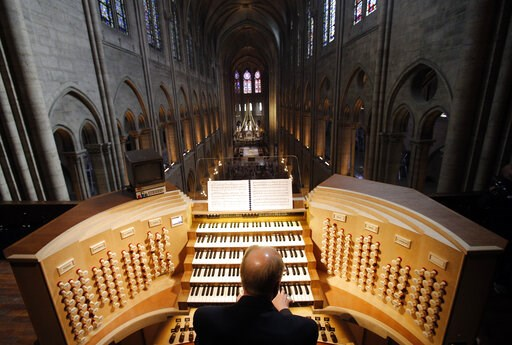 (AP Photo/Christophe Ena, file). FILE - In this Thursday, May 2, 2013 file photo, Philippe Lefebvre, 64, plays the organ at Notre Dame cathedral in Paris.