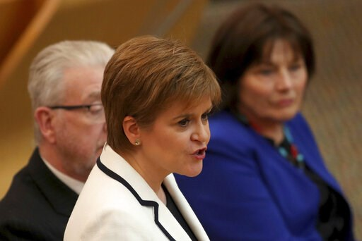 (Jane Barlow/PA via AP). First Minister of Scotland Nicola Sturgeon issues a statement on Brexit and independence in the main chamber at the Scottish Parliament, Edinburgh, Wednesday April 24, 2019. Sturgeon says she wants to hold a new referendum on i...