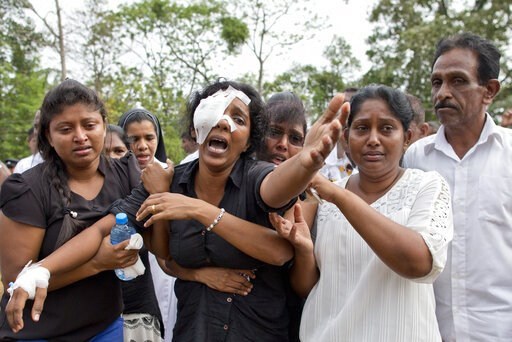 (AP Photo/Gemunu Amarasinghe). Anusha Kumari, second from left, weeps during a mass burial for her husband, two children and three siblings, all victims of Easter Sunday's bomb attacks, in Negombo, Sri Lanka, Wednesday, April 24, 2019. In an instant on...