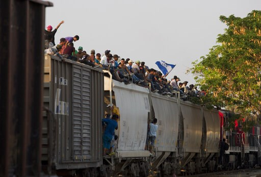 (AP Photo/Moises Castillo). Central American migrants ride atop a freight train during their journey toward the U.S.-Mexico border, in Ixtepec, Oaxaca State, Mexico, Tuesday, April 23, 2019. The once large caravan of about 3,000 people was essentially ...