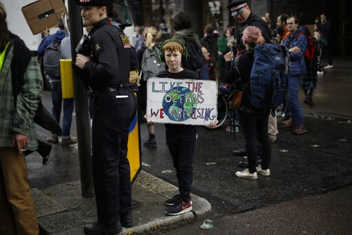 (AP Photo/Matt Dunham). A young Extinction Rebellion climate change protester holds a banner as they briefly block a road in central London, Wednesday, April 24, 2019. The non-violent protest group, Extinction Rebellion, is seeking negotiations with th...