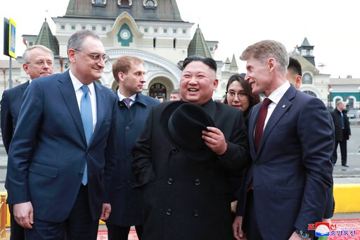 (Korean Central News Agency/Korea News Service via AP). In this Wednesday, April 24, 2019, photo, North Korean leader Kim Jong Un, center, is welcomed by Russian officials on his arrival in Vladivostok, Russia. The content of this image is as provided ...