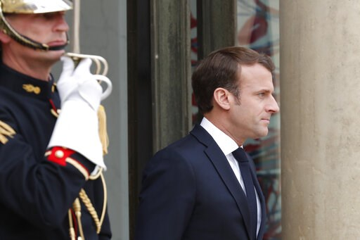 (AP Photo/Thibault Camus, File). FILE - In this April 23, 2019 file photo, French President Emmanuel Macron waits for Japan's Prime Minister Shinzo Abe at the Elysee Palace in Paris. Macron is unveiling long-awaited plans to quell the yellow vest anti-...