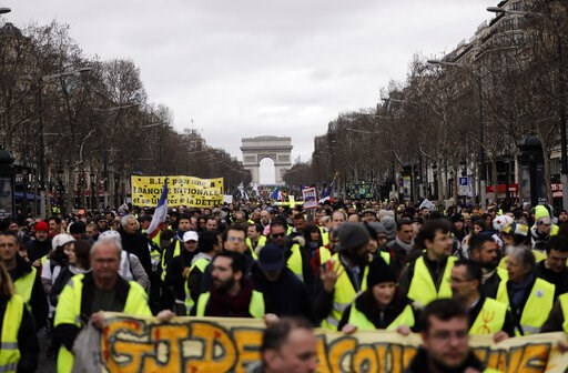 (AP Photo/Kamil Zihnioglu, File). FILE - In this March 2, 2019 file photo, Yellow Vests protesters march on the Champs Elysees avenue in Paris. France's yellow vest protesters remain a force to be reckoned with five months after their movement started,...