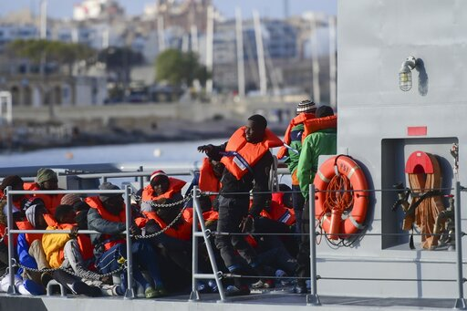 (AP Photo/Jonathan Borg). Migrants disembark after being transferred to Maltese army boats at sea and brought to Valletta harbor, Malta, Saturday, April 13, 2019. Malta has announced a deal that see four European Union nations taking in the 64 migrants...