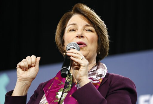 (AP Photo/John Locher, File). FILE - In this April 27, 2019, file photo, Democratic presidential candidate Sen. Amy Klobuchar, D-Minn., right, speaks at a Service Employees International Union forum on labor issues in Las Vegas. Klobuchar has released ...