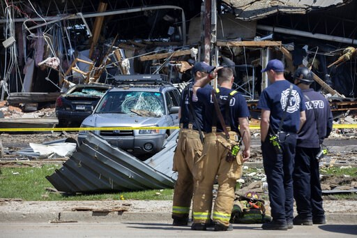 (Erin Hooley/Chicago Tribune via AP). Debris can be seen as emergency personnel and others search and clear the scene of an explosion and fire at AB Specialty Silicones chemical plant Saturday, May 4, 2019, in Waukegan, Ill.  An explosion and fire at a...