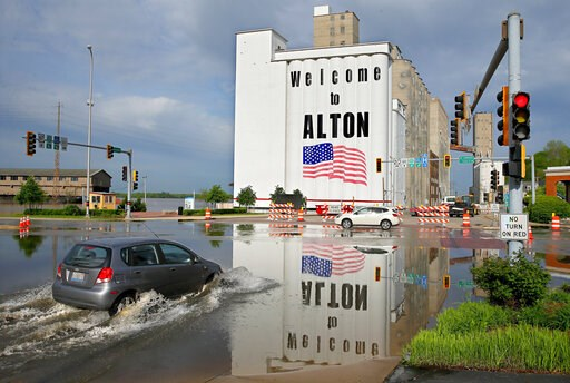 (David Carson/St. Louis Post-Dispatch via AP). A vehicle drives through Mississippi River flood water in downtown Alton, Il. on Monday, May 6, 2019. Flooding from the Mississippi River closed streets in downtown, forced the closure of Argosy Casino and...
