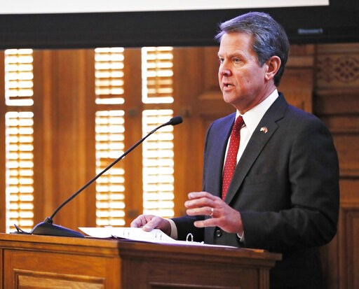 (Bob Andres/Atlanta Journal-Constitution via AP, File). FILE - In this Wednesday, Jan. 23, 2019, file photo, Georgia Gov. Brian Kemp addresses the 2019 Season Joint Budget hearings, in Atlanta. Kemp is set to sign legislation on Tuesday, May 7, 2019, b...